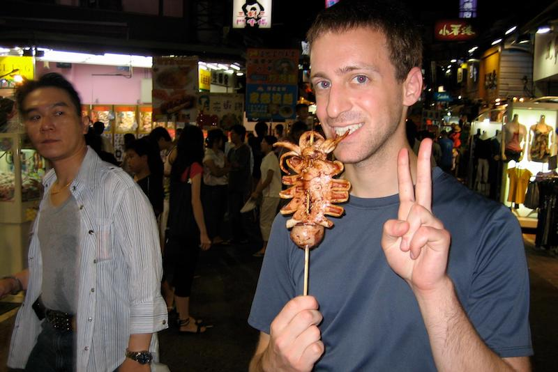 Digital Nomad Eytan Levy noshes on squid in Taiwan