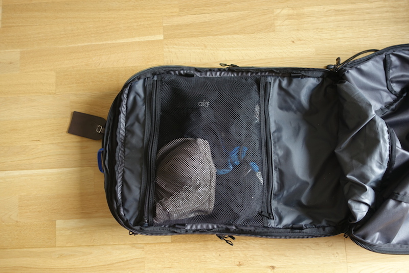 Travel gear packed into main compartment of Minaal Carry-on
