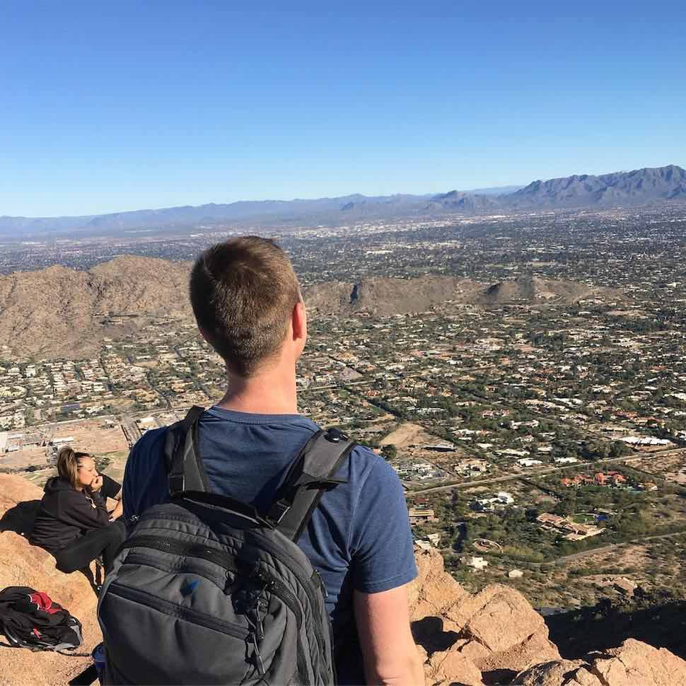 Josh at the summit of Camelback Mountain, Phoenix, Arizona with his Carry-on 1.0 hiking backpack