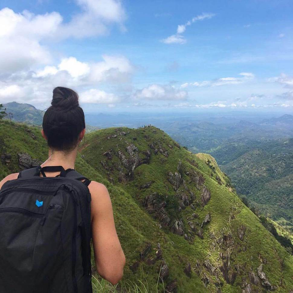 Karley hiking the green peaks of Sri Lanka with her Daily hiking backpack.