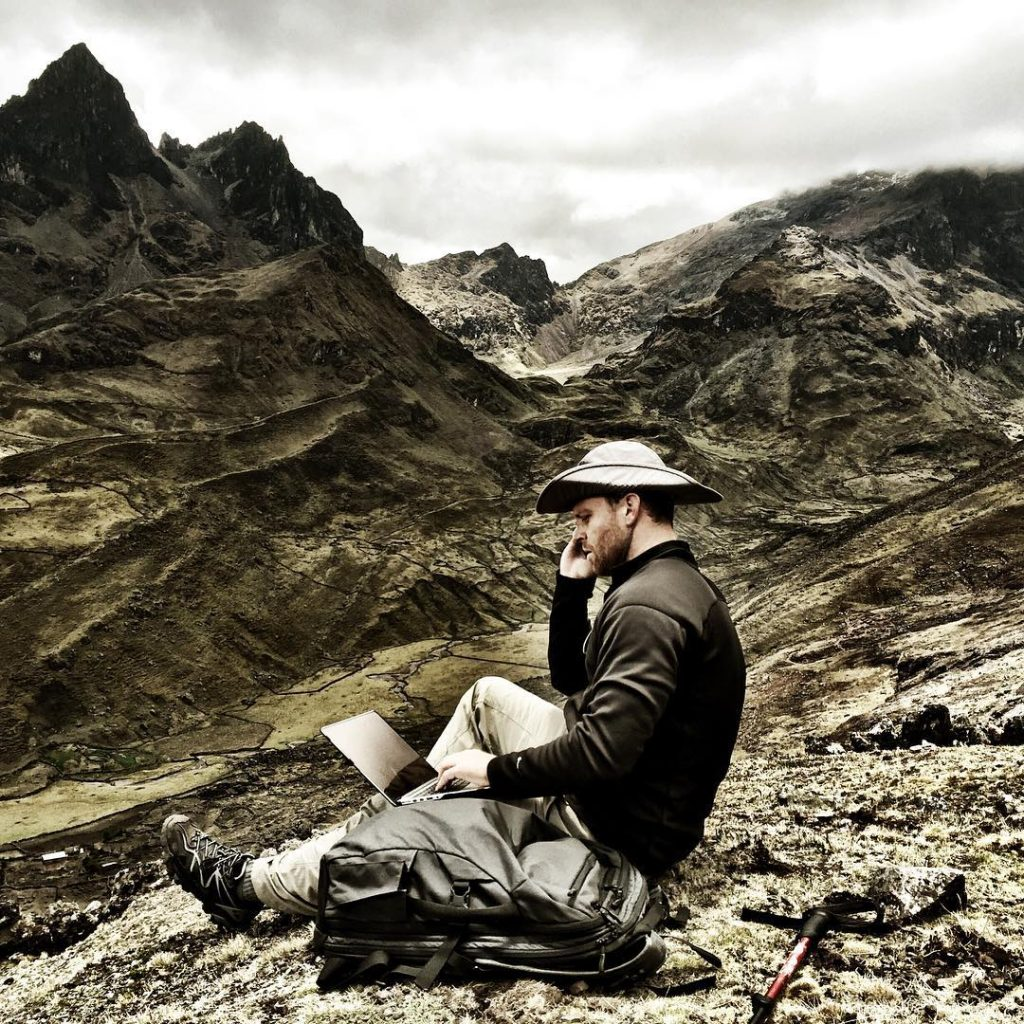 Sam hustling and hiking on the Lares Trek in Peru with his Carry-on 2.0 hiking backpack